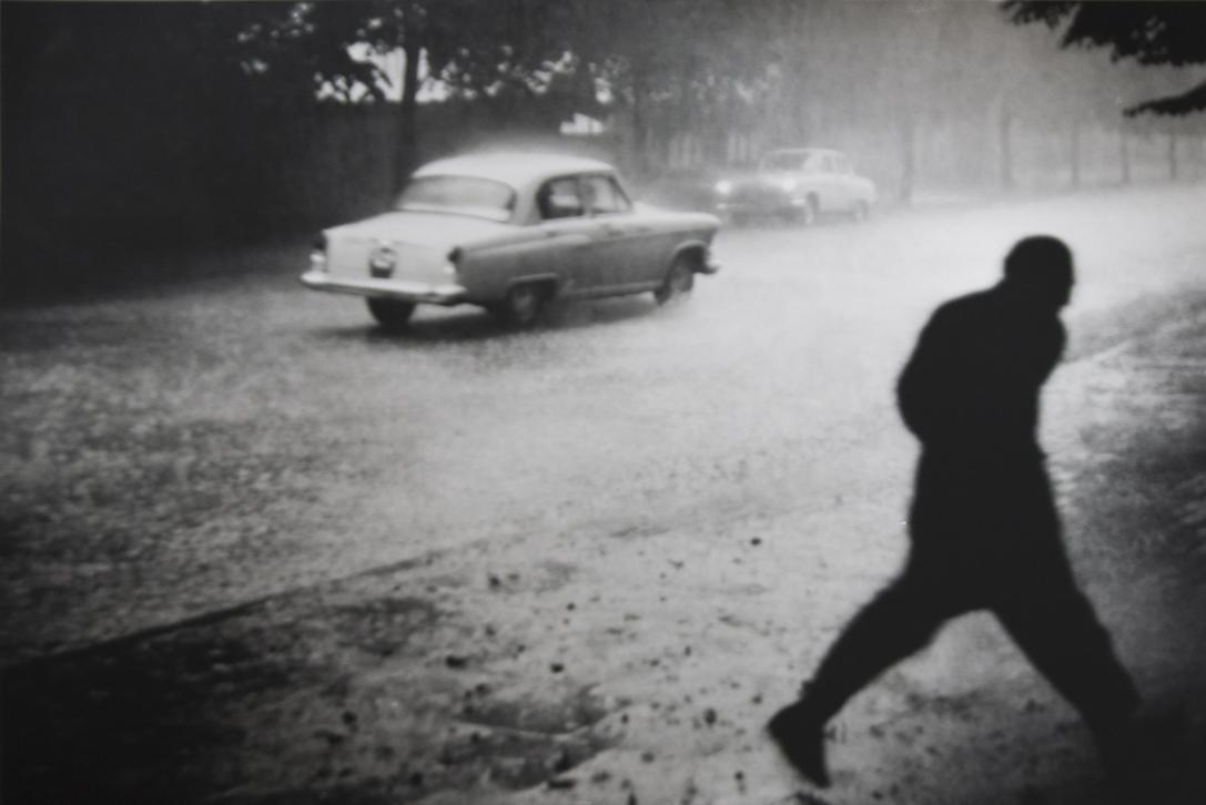 Car in the rain by Antanas Sutkus