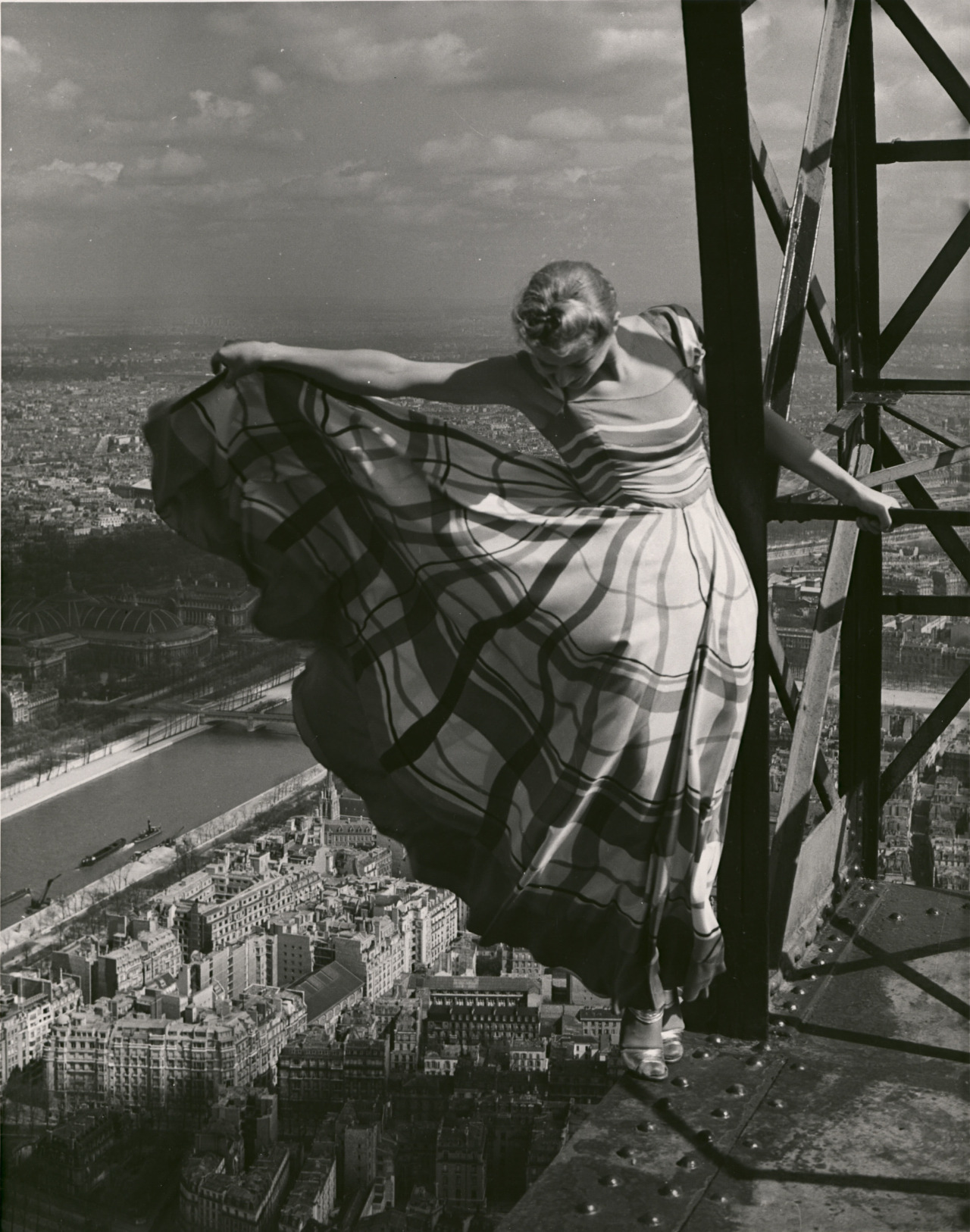 Lisa Fonssagrives wearing a Lucien Lelong dress high atop the Eiffel Tower by Erwin Blumenfeld 1939